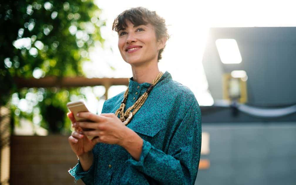 smiling woman with phone in her hands